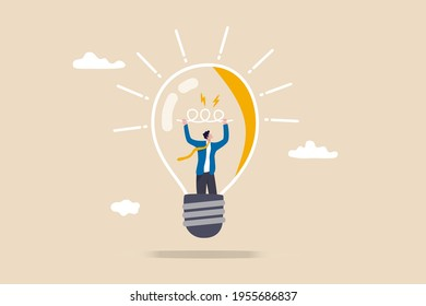 Entrepreneurship, curiosity and creativity to create new idea, motivation to success or problem solving concept, smart businessman go inside light bulb to fix or invent new idea light up bright.