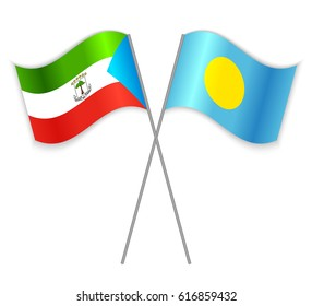 Equatorial Guinean and Palauan crossed flags. Equatorial Guinea combined with Palau isolated on white. Language learning, international business or travel concept.