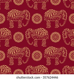 Ethnic bohemian seamless pattern. Endless texture with stylized patterned elephant and mandala in Indian style.