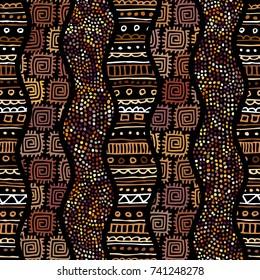 Ethnic boho seamless pattern in african style on black background. Tribal art print. Irregular polka dots pattern.
