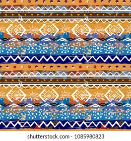 Ethnic boho seamless pattern. Tribal art print. Abstract background texture. Geometric ornament, paint spots