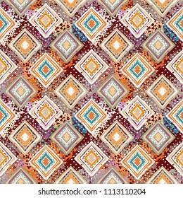 Ethnic seamless pattern. Tribal art boho print. Abstract tiled geometric background texture. Paint spots