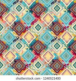 Ethnic seamless pattern. Tribal art boho print. Abstract tiled geometric background. Grunge texture. Paint spots