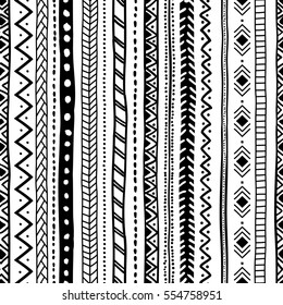 Ethnic seamless pattern. Vertical orientation. Black and white ornament handmade. Tribal and aztec motifs. Vector illustration.