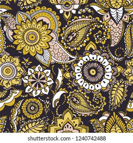 Ethnic seamless pattern with yellow buta motifs and Persian floral mehndi elements on black background. Colored decorative vector illustration for fabric print, wallpaper, wrapping paper, backdrop.