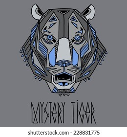 Ethnic style tiger's head vector drawing. Colored in monochrome tones