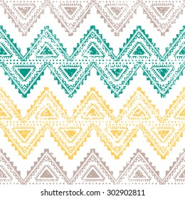 Ethnic vintage ornament. Horizontal stripes. Old background. Handmade. Gray, yellow, green zigzag on a white background.