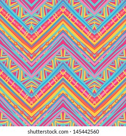 Ethnic zigzag pattern in retro colors, African style seamless vector background