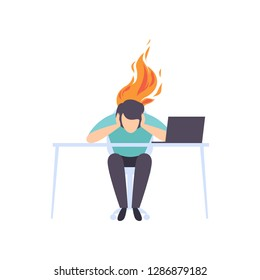 Exhausted tired man sitting at his working place with computer in office, businessman with burning brain, emotional burnout concept