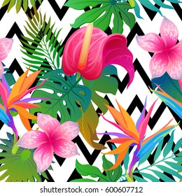 Exotic leaves and flowers on geometrical ornament. Seamless tropical pattern. Vector background with paradise bird flower and zigzag