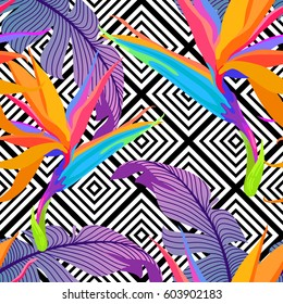 Exotic leaves and flowers on geometrical ornament. Seamless tropical pattern. Vector background with paradise bird flower and rhombus.