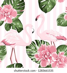 Exotic pink flamingo birds couple. Bright camelia flowers. Tropical monstera philodendron green leaves. Trendy seamless pattern with vertical stripes background. Vector design illustration.