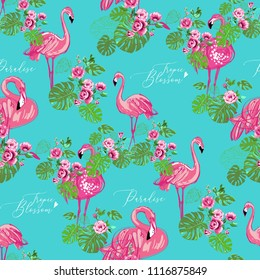 Exotic pink flamingo pattern. Vector seamless background with fashionable tropic birds, palm foliage and flowers. Wild nature decoration on blue backdrop. Colorful hand drawn flamingo illustration.