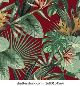 Exotic strelitzia, bird of paradise flowers and tropical palm, banana, monstera green leaves seamless vector pattern on red background. Beach creative wallpaper