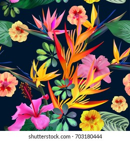 Exotic tropical strelitzia flowers on a dark background.Creative tropical seamless pattern