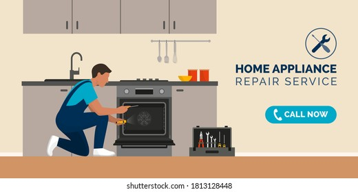 Expert repairman fixing a broken oven in a kitchen, home appliance repair service concept