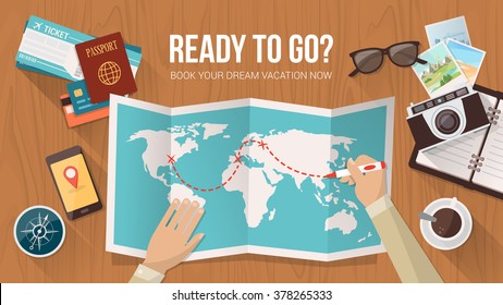 Explorer planning a trip around the world, he is tracing the route on the map, travel and adventure concept