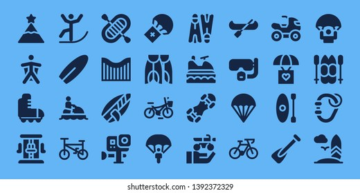extreme icon set. 32 filled extreme icons. on blue background style Collection Of - Peak, Wingsuit, Roller skate, Roller coaster, Skiing, Surfboard, Jet ski, Bicycle, Rafting