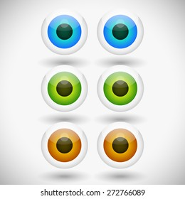 Eye, eyeball graphics in different colors. Green, brown and blue eyes. Editable vector.