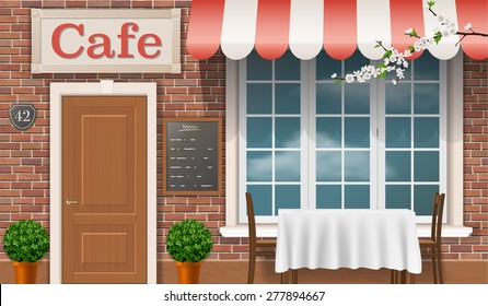 Facade of a traditional cafe with a window, door, awnings.
