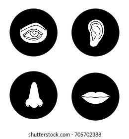 Facial body parts glyph icons set. Eye, nose, ear, lips. Vector white silhouettes illustrations in black circles