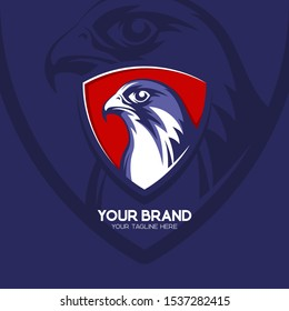 Falcon head logo badge in blue & red color. Eagle esport emblem. Hawk logo illustration. Falcon head with triangle shield. Eps10.