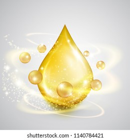 Falling drop of golden oil with shiny winds. Precious liquid scin care emulsion, symbol of organic nutrition, natural make up components, healthy cooking, ecological production, isolated on white.