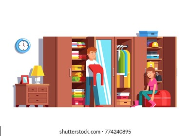 Family couple husband & wife getting dressed together at home wardrobe. Man putting on clothes, woman taking off boots. Dressing room with big full closet. Flat vector illustration isolated on white.
