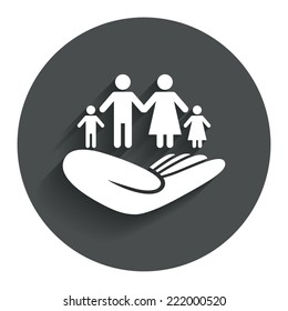 Family life insurance sign. Hand holds human group symbol. Health insurance. Circle flat button with shadow. Modern UI website navigation. Vector