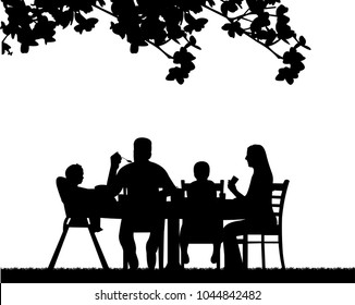 A family lunch outdoors in the garden  one in the series of similar images silhouette