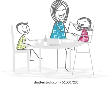 Family meal. A parent or nanny do eating a young child around a table, a second child eat alone