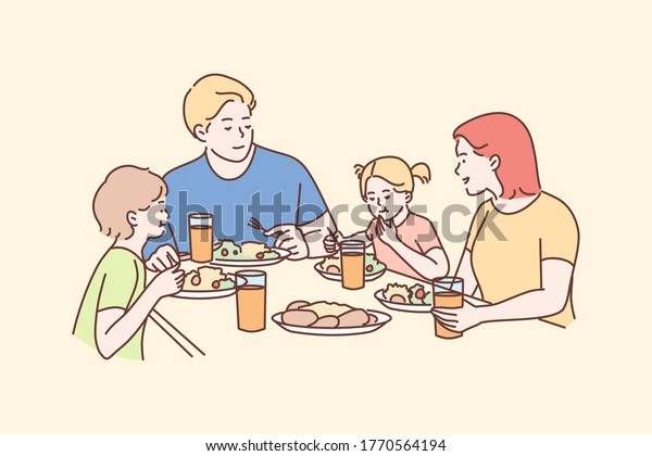 Family, meal, recreation, leisure, dinner, fatherhood, motherhood, childhood concept. Man dad woman mom children kids son daughter eating breakfast dinner lunch supper together. Fathers or mothers day