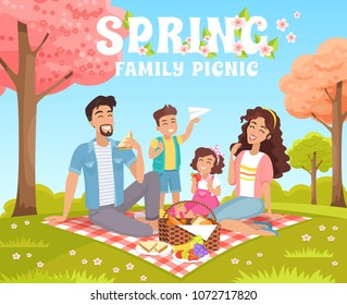 Family picnic in the park. Spring vacation. Happy family with children