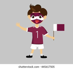 Fan of Qatar national football team, sports. Boy with flag in the colors of the national command with sports paraphernalia.