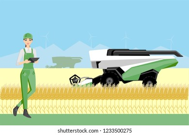 Farmer controls an autonomous combine harvester. Internet of things in agriculture