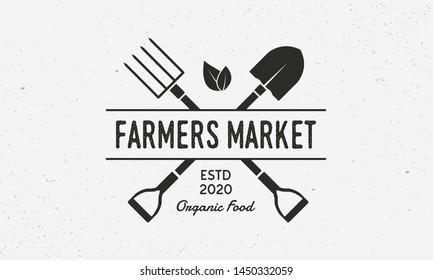 Farmers Market vintage logo. Organic food store logo with shovel and pitchfork. Vector illustration