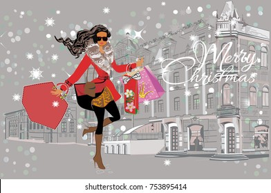 Fashion girl in a hat and in  a coat  shopping in the street of the old city. Christmas card.
