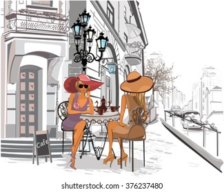 Fashion girls in the street cafe.