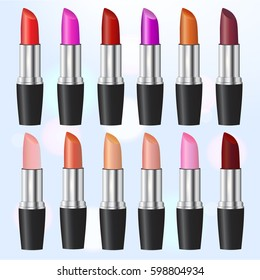 Fashion lipstick ads, colorful lipsticks arranged isolated on blue background, trendy cosmetic design for advertisement. Set of lipsticks.