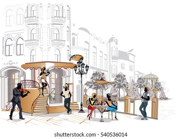 Fashion people in the restaurant. Street cafe with flowers in the old city. Waiters serve the tables.