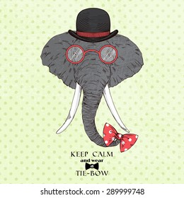fashion portrait of elephant in bowler hat and bow-tie