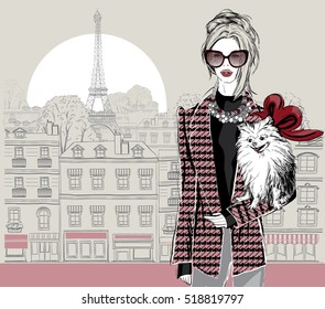 Fashion woman model with a little dog on Paris city background,  vector illustration