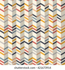 Fashion zigzag pattern in yellow, orange, red and navy blue colors on light yellow background. Seamless chevron pattern. Vector background with zig-zag waves. Multicolor chevron background