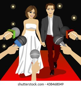 Fashionable couple on a red carpet event before press reporters