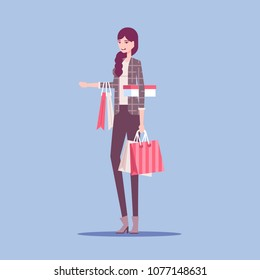 Fashionable young woman standing with a lot shopping bags. Shop sale, black friday vector flat illustration.