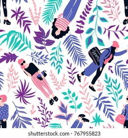 Fashionable young women in casual style with tropical leaves on the white  background. Vector hand drawn stylish seamless pattern with girls. Tropical fabric design.