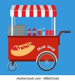 Fast food hot dog cart and street hot dog cart with awning. Hot dog cart street food market, hot dog cart stand vendor service. Kiosk seller fast food business. Ketchup soda water bottle on the desk