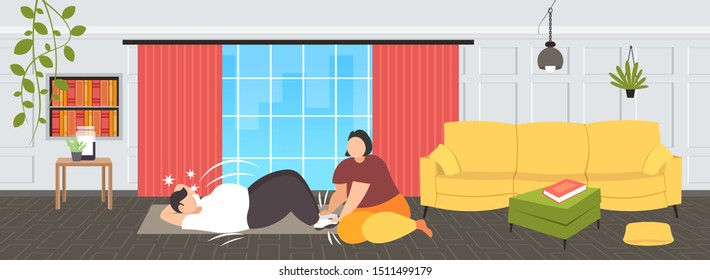 fat man doing sit-ups abdominal exercises with overweight woman holding his legs obese couple training together workout weight loss concept modern living roo interior flat full length horizontal
