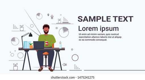 fat obese businessman drinking cola overweight african american guy sitting at workplace desk with laptop unhealthy nutrition obesity concept flat full length horizontal copy space