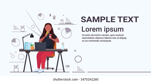 fat obese businesswoman eating sandwich drinking cola overweight african american girl sitting at workplace desk with laptop unhealthy nutrition obesity concept full length horizontal copy space